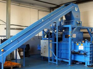 Part of the business shredding plant at Let's Talk Shred's warehouse